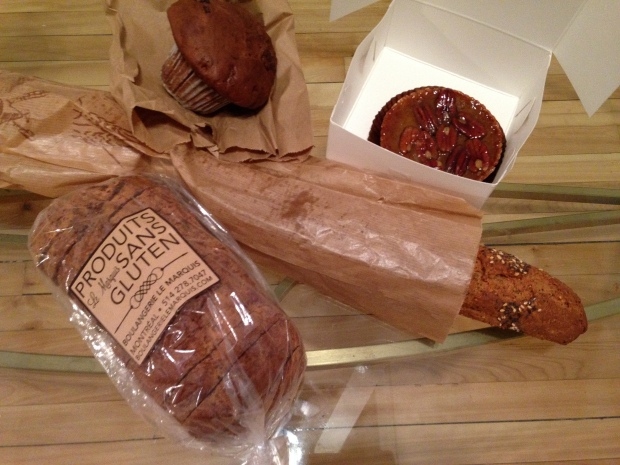 My purchases: multigrain baguette, quinoa bread, chocolate muffin and a pecan tart