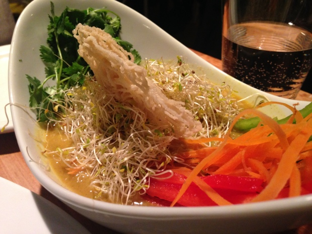 Vermicelli rice noodles in a creamy curry & coconut sauce with its julienne vegetable, fresh sprouts & coriander
